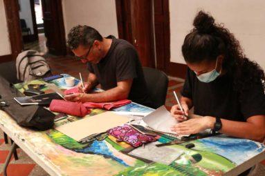 hombre y mujer dibujando